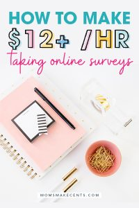 survey junkie review text with pink notebook