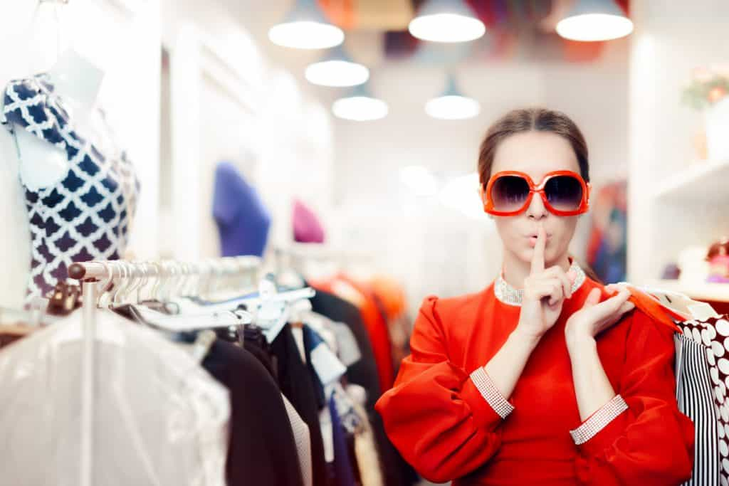woman with sunglasses shopping for example in the best mystery shopping companies post