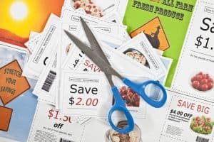 picture of coupons with scissors for the featured image on the post best restaurant coupon apps
