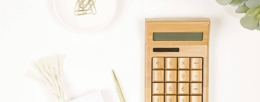 Gold calculator on a white desk
