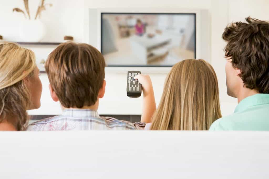 Family watching tv - example for how to lower your comcast bill