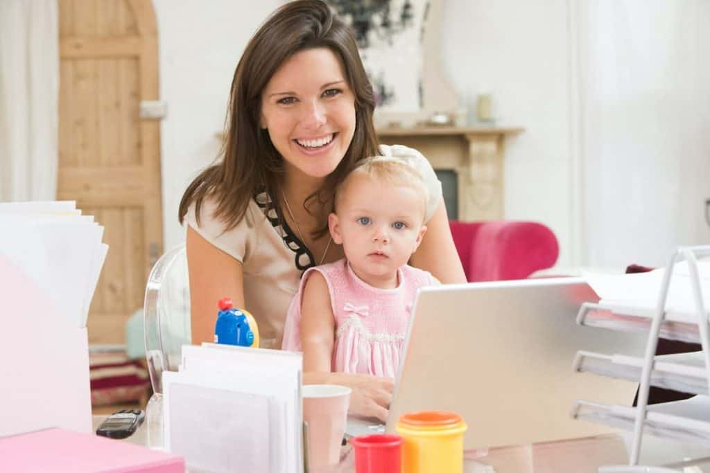 Woman with child working on her home business